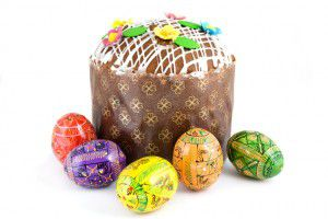 easter eggs and cake isolated on white