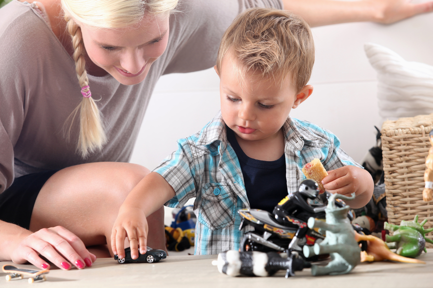 Mother and child playing with toy cars