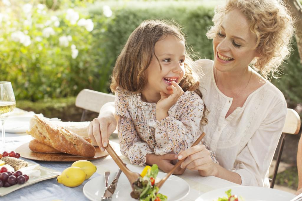 mother-and-daughter-eating-in-garden-1
