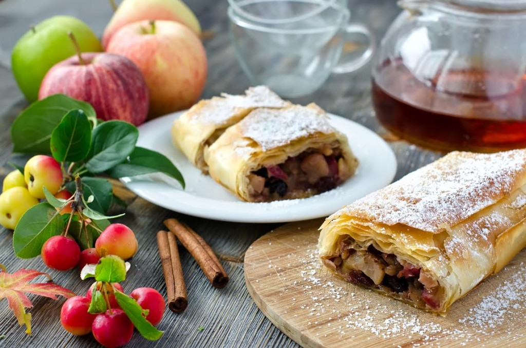 Baked fruitcake on wooden background