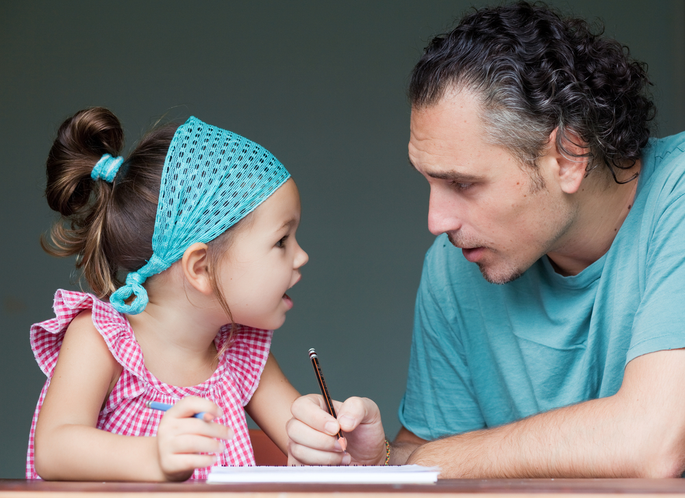 father-and-daughter-writing
