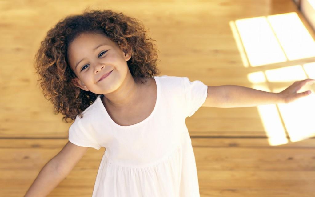 6941277-child-girl-smile-white-dress-mood