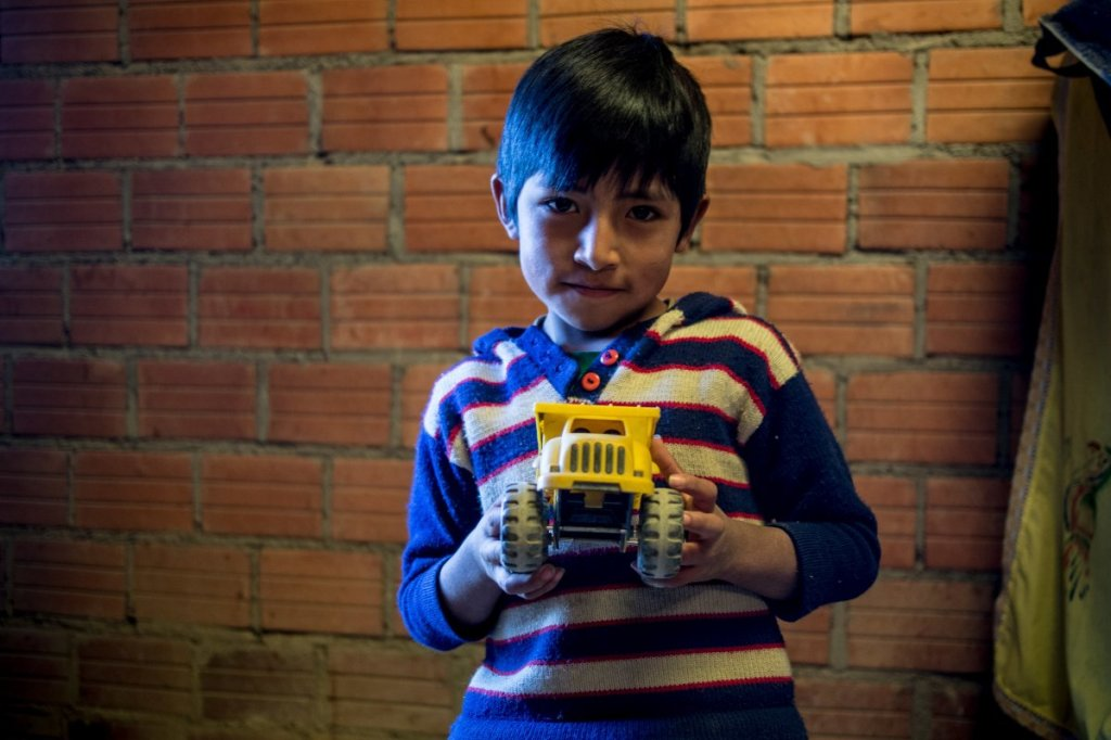 in-a-bolivian-home-living-on-265month-per-adult-the-favorite-toy-is-a-toy-truck
