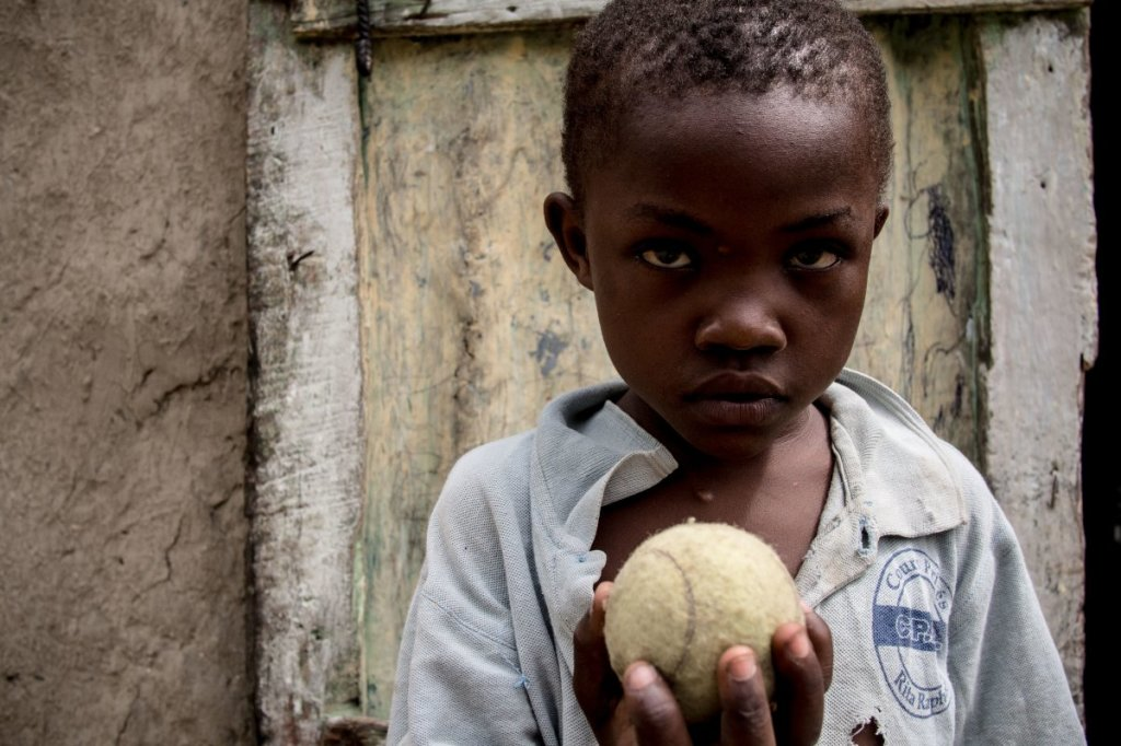 in-a-haitian-home-living-on-39month-per-adult-the-favorite-toy-is-a-tennis-ball