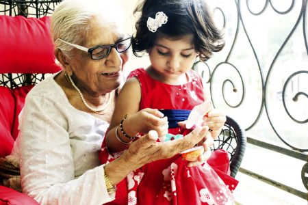 yowoto-indian-toddler-girl-playing-with-grandmother-450x300
